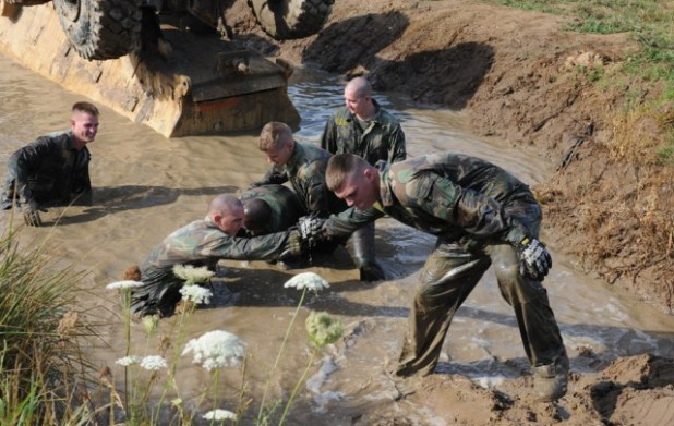Marines Help Each Other Out Of The Restraining Mud Pit After Successfully Recovering Buffalo Mine