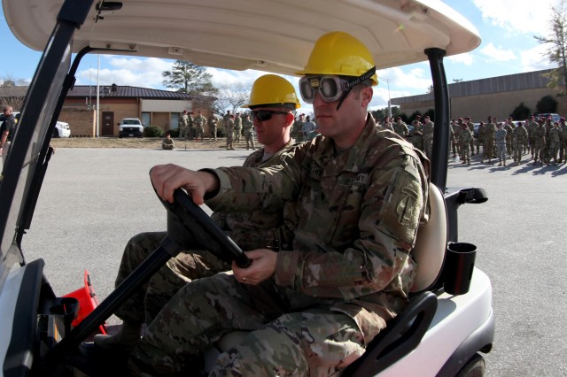 """Lt. Col. Patrick McCarthy, Commander of 7th Military Information Support Battalion, 4th Military Information Support Group, attempted to navigate a simple cone driving course while wearing vision distorting """"drunk goggles"""" meant to simulate a blood alcohol content between .08 and .15, Jan. 12, 2017. The Fort Bragg Provost Marshall Office Traffic Division assisted 7th Military Information Support Battalion, to conduct an alcohol awareness safety class to raise awareness of alcohol's rapid effects and to deter drunken driving. (U.S. Army photo by Capt. Stephen Von Jett/Released)"""
