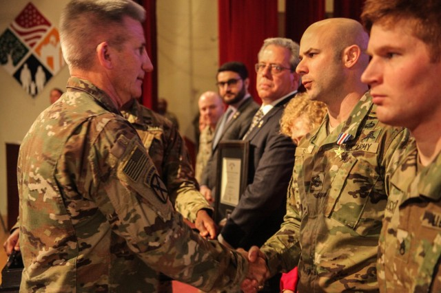 Gen. John Nicholson, commander of the Resolute Support mission and U.S. Forces-Afghanistan (Left), congratulates Sgt. 1st Class Brian Seidl, 10th Special Forces Group (Airborne), after presenting him with the Silver Star award on Fort Carson, Colo., Feb 1, 2017. Seidl earned the Silver Star for his heroic actions during the Battle of Boz Qandahari, Afghanistan on Nov. 2-3, 2016.