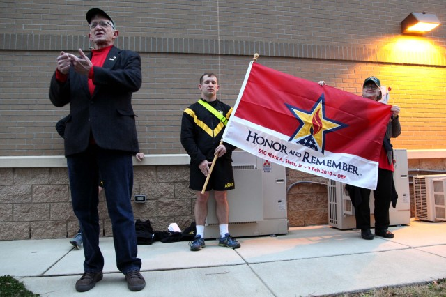 "Mark Stets speaks to a formation of 8th Military Information Support Battalion, 4th Military Information Support Group, Paratroopers and leaders following a battalion four-mile run on Feb. 3, 2017, honoring his son, Staff Sgt. Mark Stets, Jr., who was killed in action Feb. 3, 2010. Unit leaders and Stets' parents took time before and after the run to speak of their memories of the fallen Soldier. The formation ran with Stets' ""Honor and Remember"" flag in front of the battalion colors."