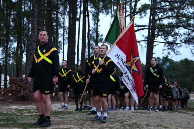 """Lt. Col. Marcus Welch, commander of 8th Military Information Support Battalion, 4th Military Information Support Group, returns from a four-mile run with his Paratroopers on Feb. 3, 2017, honoring Staff Sgt. Mark Stets, Jr., who was killed in action Feb. 3, 2010. Unit leaders and Stets' parents took time before and after the run to speak of their memories of the fallen Soldier. The formation ran with Stets' """"Honor and Remember"""" flag in front of the battalion colors."""