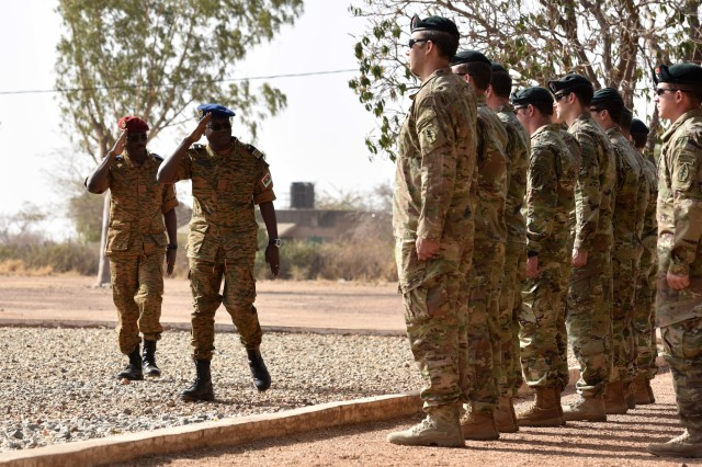 Colonel Major TN Pale, the Burkina Faso Army Chief of Staff, salutes U.S. Special Forces during the opening ceremony of Flintlock 2017 in Camp Zagre, Burkina Faso on February 27, 2017. Flintlock allows partner nations to build and strengthen relationships that are essential to creating lasting security and the ability to effectively respond to crisis. (U.S. Army photo by Sgt Benjamin Northcutt 3rd Special Forces Group (Airborne) Public Affairs Sergeant/released)