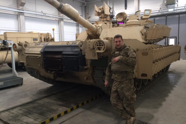 Capt. James England, commander, Company B, 1st Battalion, 66th Armor Regiment, 3rd Armored Brigade Combat Team, 4th Infantry Division, stands in front of an M1A2 Abrams main battle tank with newly installed Abrams reactive armor tiles (ARAT) at the 7th Army Training Command's Grafenwoehr Training Area, Germany, Feb. 28, 2017. The installation of the ARAT will enhance the tank's defensive capabilities, providing a greater deterrent against aggression as the 3rd ABCT maintains a persistent presence in central and eastern Europe as the rotational ABCT for Atlantic Resolve.