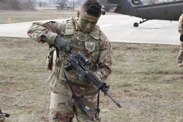 U.S. Army Pvt. Daniel Raya, a member of Bravo Company, 1st Battalion, 8th Infantry Regiment, 3rd Armored Brigade Combat Team, 4th Infantry Division, from Fort Carson, Colorado, demonstrates a functions check of his M-4 rifle before beginning training at Mihail Kogalniceanu Air Base, Romania on March 3, 2017. Raya's skills have been honed to make him an effective soldier serving in support of Operation Atlantic Resolve. He and his company have been working closely with Romanian forces to strengthen U.S. and European relations as well as to deter aggression in Europe. (US Army photo taken by Pvt. Nick Vidro, 7th Mobile Public Affairs Detachment)