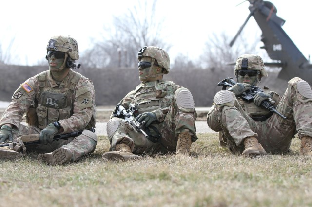 U.S. Army Soldiers of Bravo Company, 1st Battalion, 8th Infantry Regiment, 3rd Armored Brigade Combat Team, 4th Infantry Division, from Fort Carson, Colorado, sit while awaiting clearance to board a UH-60 Black Hawk at Mihail Kogalniceanu Air Base, Romania on March 3, 2017. The team was preparing to conduct air to ground training as part of Operation Atlantic Resolve, which will see U.S. forces working with Romanian troops to deter aggression and promote stability across Europe. (US Army photo taken by Pvt. Nick Vidro, 7th Mobile Public Affairs Detachment)