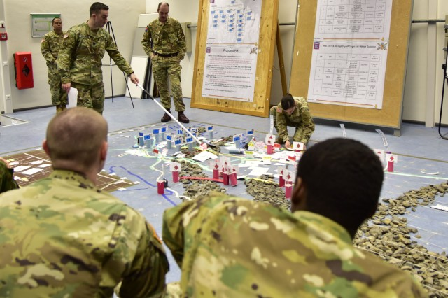 Grafenwoehr, Germany (March 6, 2017) - Participants in Dynamic Front II conducts a operations meeting using their terrain map at the 82nd Airborne Division Artillery tactical operations center here. Dynamic Front II is an artillery operability exercise taking place at the 7th Army Training Command's Grafenwoehr Training Area, Germany, Feb. 26 to March 10. (US Army photo by Staff Sgt. Kathleen V. Polanco)