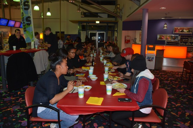 Members of the garrison's BOSS program enjoy Thanksgiving dinner at the Galaxy Bowling Center, Panzer Kaserne, 2016.