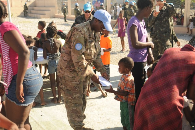 Maj. Windy Waldrep interacts with children at a holiday event for children hosted by MINUSTAH's Brazilian Battalion in Cite Soleil, Dec. 23, 2016. Approximately 150 children participated in the festivities.