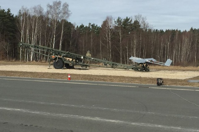 RQ-7B Shadow unmanned aerial system operators from Company D, 588th Brigade Engineer Battalion, 3rd Armored Brigade Combat Team, 4th Infantry Division, prepare to launch the brigade's first UAS flight in Europe at Grafenwoehr Training Area, Germany, March 3, 2017. D Co.'s UAS platoon is integrating its capabilities with fire-support elements from the brigade's 1st Battalion, 66th Armor Regiment, to gear up for major multinational exercises planned for this spring as part of Atlantic Resolve.
