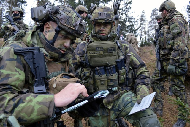 Czech soldiers, assigned to 13th Field Artillery Regiment, plan for a mission as part of Exercise Dynamic Front II at the 7th Army Training Command's Grafenwoehr Training Area, Germany, March 8, 2017. (U.S. Army photo by Sarah Tate)