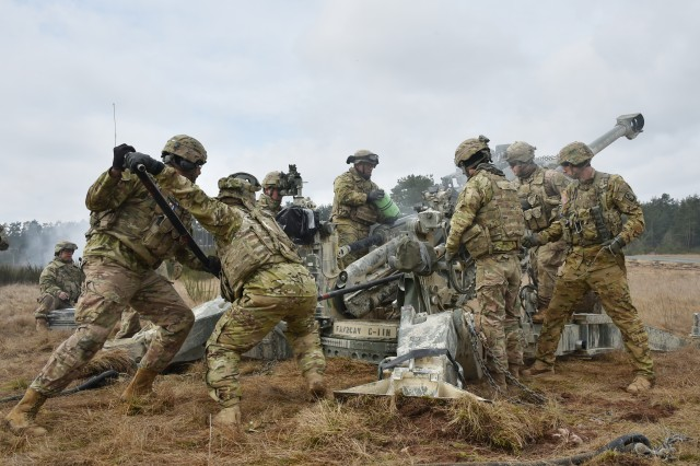 U.S. Soldiers, assigned to Cobra Battery, Field Artillery Squadron, 2nd Cavalry Regiment, conduct a fire mission with a M777 Howitzer during Exercise Dynamic Front II at the 7th Army Training Command's Grafenwoehr Training Area, Germany, March 9, 2017. (U.S. Army photo by Visual Information Specialist Gertrud Zach)
