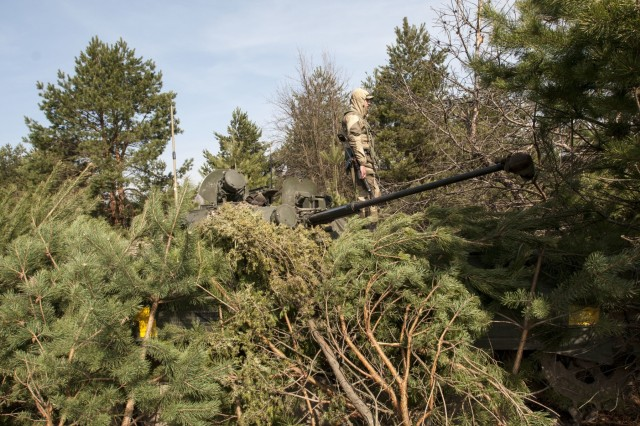 A Ukrainian soldier of the 1st Battalion, 28th Mechanized Infantry Brigade watches from atop his BMP-2 for approaching opposing force role players during a battalionwide defensive training operation at the Yavoriv Combat Training Center on the International Peacekeeping and Security Center, near Yavoriv, Ukraine on March 29. Ukrainian soldiers of the 1st Battalion, 28th Mechanized Infantry Brigade man battle positions during a battalion wide defensive training exercise at the Yavoriv Combat Training center on the International Peacekeeping and Security Center, near Yavoriv, Ukraine, on March 29. The 1-28 battalion defense exercise was the culminating event for the unit's rotation through the CTC. During their time at the CTC, soldiers learned individual-, squad-, platoon- and company-level defensive tactics from their international partners in the Joint Multinational Training Group - Ukraine.