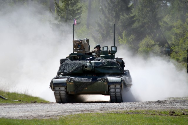 "Team United States, from 1st Battalion 66th Armor Regiment ""Iron Knights"", 3rd Brigade Combat Team, 4th Infantry Division (Iron Brigade) maneuvers the vehicle identification lane during the Strong Europe Tank Challenge at the 7th Army Training Command's Grafenwoehr Training Area, Germany, May 11, 2017."