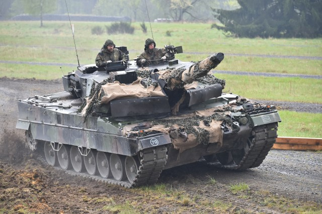 Bundeswehr soldiers maneuver their Leopard 2A6 tank through the Precision Driving lane during the Strong Europe Tank Challenge at the 7th Army Training Command's Grafenwoehr Training Area, Germany, May 08, 2017.