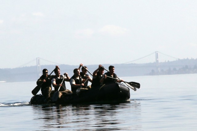 "Soldiers from 3rd Battalion, 1st Special Forces Group (Airborne), paddle through the Puget Sound during a competition as part of ""Dragon Week"" held on Joint Base Lewis McChord, Wash., June 29. Dragon Week consisted of airborne operations, maritime operations, patrol lanes, a stress shoot, and medical evaluations to test readiness at the battalion level."