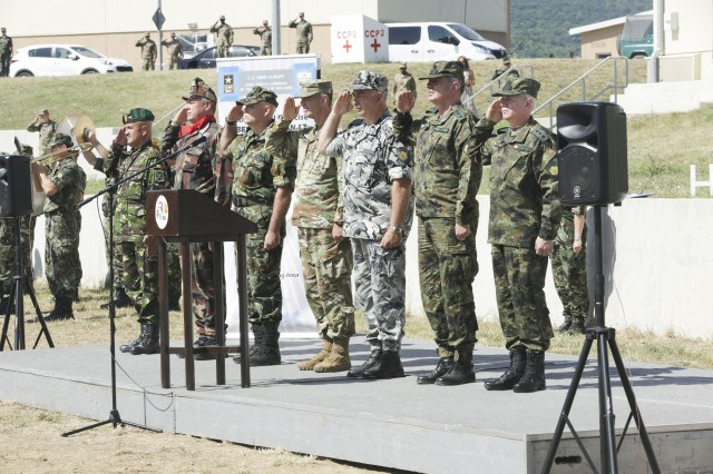 Leadership from participating nations render honors for the host nations' national anthems during the opening ceremony for exercise Saber Guardian 17 at Novo Selo Training Area, Bulgaria, July 11, 2017. Saber Guardian is a U.S. Army Europe-led, multinational exercise that spans across Bulgaria, Hungary, and Romania with more than 25,000 service members from 22 allied and partner nations.