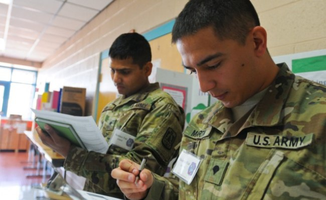 86th Esb Soldiers Judge Elementary School Science Fair