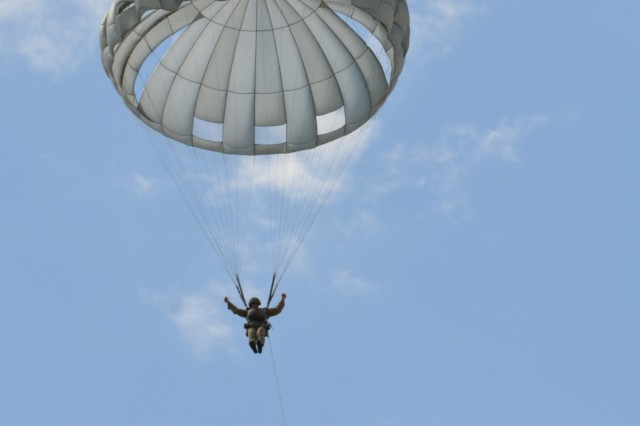 VAZIANI TRAINING AREA, Georgia - A British soldier of the 2nd Battalion, Parachute Regiment (2nd PARA), 16th Air Assault Brigade, Essex, England, pulls his parachute at Vaziani Training Area, Georgia, Aug. 7, 2017. The 2nd PARA is currently in the Republic of Georgia to participate in Exercise Noble Partner. Noble Partner is a multinational, U.S. Army Europe-led exercise conducting home station training for the Georgian light infantry company designated for the NATO Response Force. (U.S. Army photo by Sgt. Shiloh Capers)