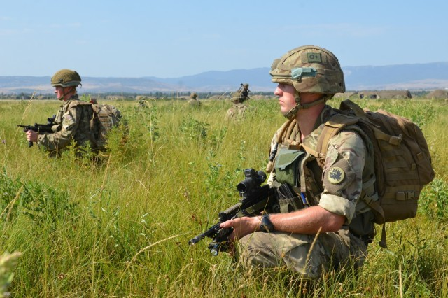 VAZIANI TRAINING AREA, Georgia - British soldiers pull security at the collection point after jumping into the drop zone, on Vaziani Training Area, Georgia, Aug. 7, 2017. The 2nd PARA is currently in the Republic of Georgia to participate in Exercise Noble Partner. Noble Partner is a multinational, U.S. Army Europe-led exercise conducting home station training for the Georgian light infantry company designated for the NATO Response Force. (U.S. Army photo by Sgt. Shiloh Capers)