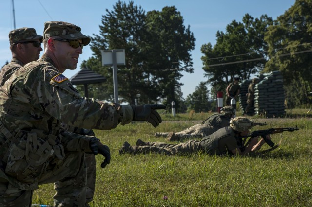 U.S. Army Soldiers acting as Observer Controller Trainers watch as Ukrainian soldiers react to enemy fire at an entry control point during exercise Rapid Trident 16 July 5, 2016. (U.S. Army photo by Sgt. 1st Class Whitney Hughes/Released)