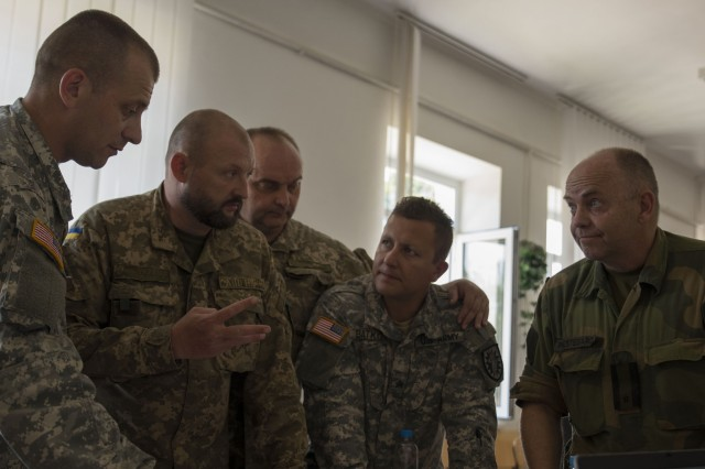 Soldiers from the U.S. Ukraine, and Norway participate in a Command Post Exercise, June 29, 2016, as a part of Exercise Rapid Trident 16. (U.S. Army photo by Sgt. 1st Class Whitney Hughes/Released)
