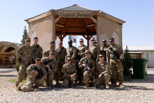 Medics assigned to Task Force Forge pose for a group photo on the occasion of the redeployment of their colleagues, in Helmand Province, Afghanistan, March 10, 2017. Members of the 947th Forward Surgical Team of West Hartford, Conn., have been serving in theater since July 2016.