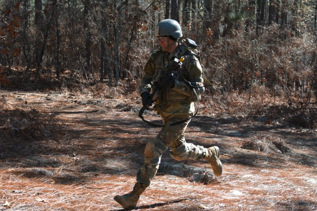 A trainee with Bravo Company, 4th Battalion, 39th Infantry Regiment seeks cover Jan. 18 during training with the multiple integrated laser engagement system at Remagen Range on Fort Jackson.