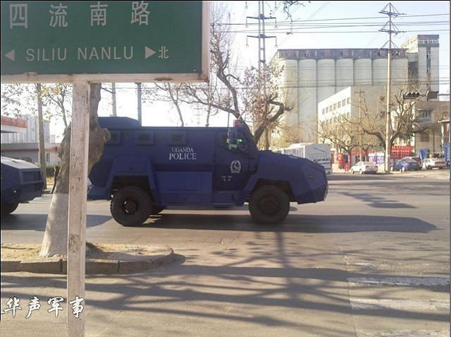 "A picture take in China shows a convoy of anti-riot armoured vehicle on the way to be transfer in Africa. On the sides of the vehicles it is written ""Uganda Police""."