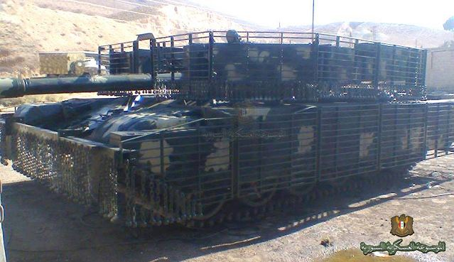 Tank crews of the Syrian army use T-72 main battle tank especially upgraded for urban warfare. A photo released on Internet show a Syrian army T-72M1 main battle tank fitted with new wire cage armor to increase protection against anti-tank guided missiles and rocket-propelled grenades.