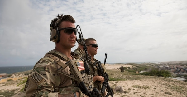 Two U.S. Army soldiers look out at Mogadishu during operations in the region. (National Geographic/James Peterson)