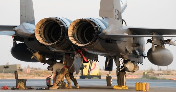 Airmen with the 332nd Expeditionary Maintenance Squadron out of RAF Lakenheath, England, work on an F-15E Strike Eagle in April 2018 at an undisclosed location in Southwest Asia. The aircraft are with the 494th Expeditionary Fighter Squadron and support Operation Inherent Resolve.. (Senior Airman Krystal Wright/Air Force)