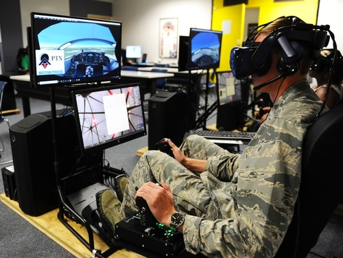 Cadet 1st Class Cade Cavanagh uses a virtual reality system to practice flying skills during a Pilot Training Next course in Summer 2019 at the Air Force Academy airfield. Capella Space's Synthetic Aperture Radar images could be used in future virtual reality scenarios. (Jennifer Spradlin/Air Force Academy)