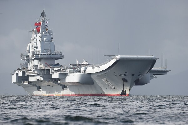 The Chinese aircraft carrier Liaoning arrives in Hong Kong waters on July 7, 2017, less than a week after a high-profile visit by Chinese President Xi Jinping. (Anthony Wallace/AFP via Getty Images)