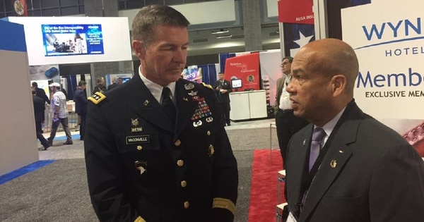 ROCKS Inc. president retired Brig. Gen. Earl Simms, right, speaks with Gen. James McConville, Army vice chief of staff, during a recent Association of the U.S. Army exhibition. (Courtesy of The ROCKS, Inc.)