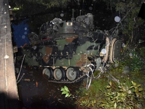 An M2A3 Bradley is pulled from a creek after flipping over a bridge at Fort Stewart, Georgia, on Oct. 20, 2019. (Army/FOIA)