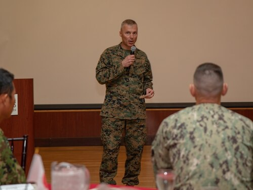 Marine Corps Col. Christopher J. Bronzi, center, commanding officer of 15th Marine Expeditionary Unit, gives his remarks during the closing ceremony for Exercise Iron Fist 2020 on Marine Corps Base Camp Pendleton, California, Feb. 21, 2020. (Cpl. Anabel Abreu Rodriguez/Marine Corps)