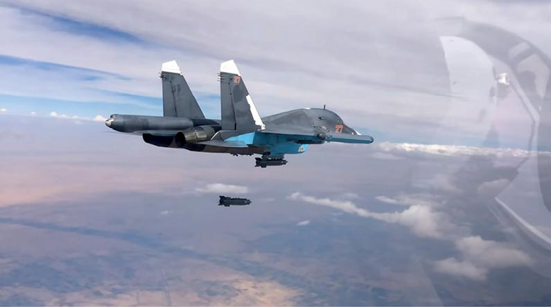 A Russian Sukhoi Su-34 fighter-bomber aircraft drops a KAB-500S, a 560 kg satellite-guided bomb