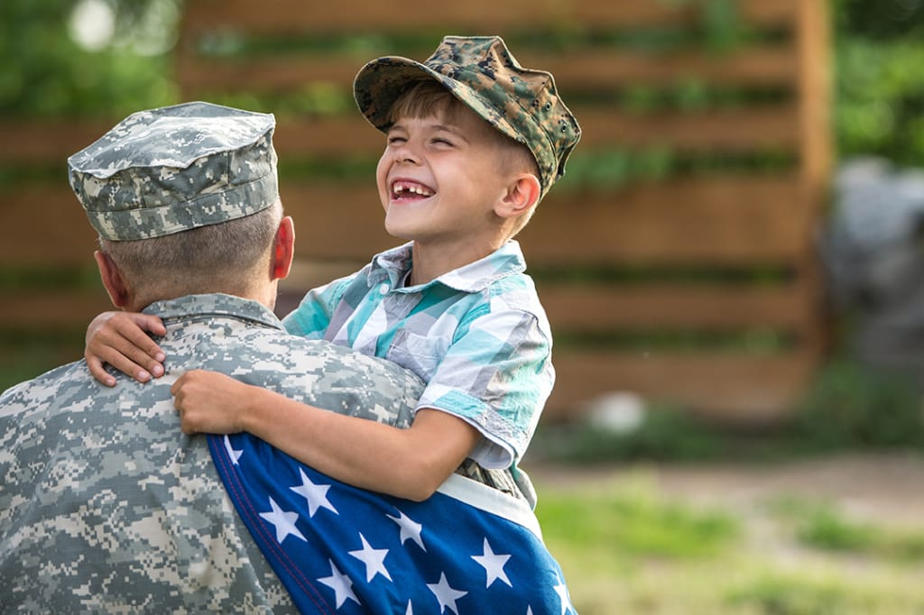 Military man with smiling son