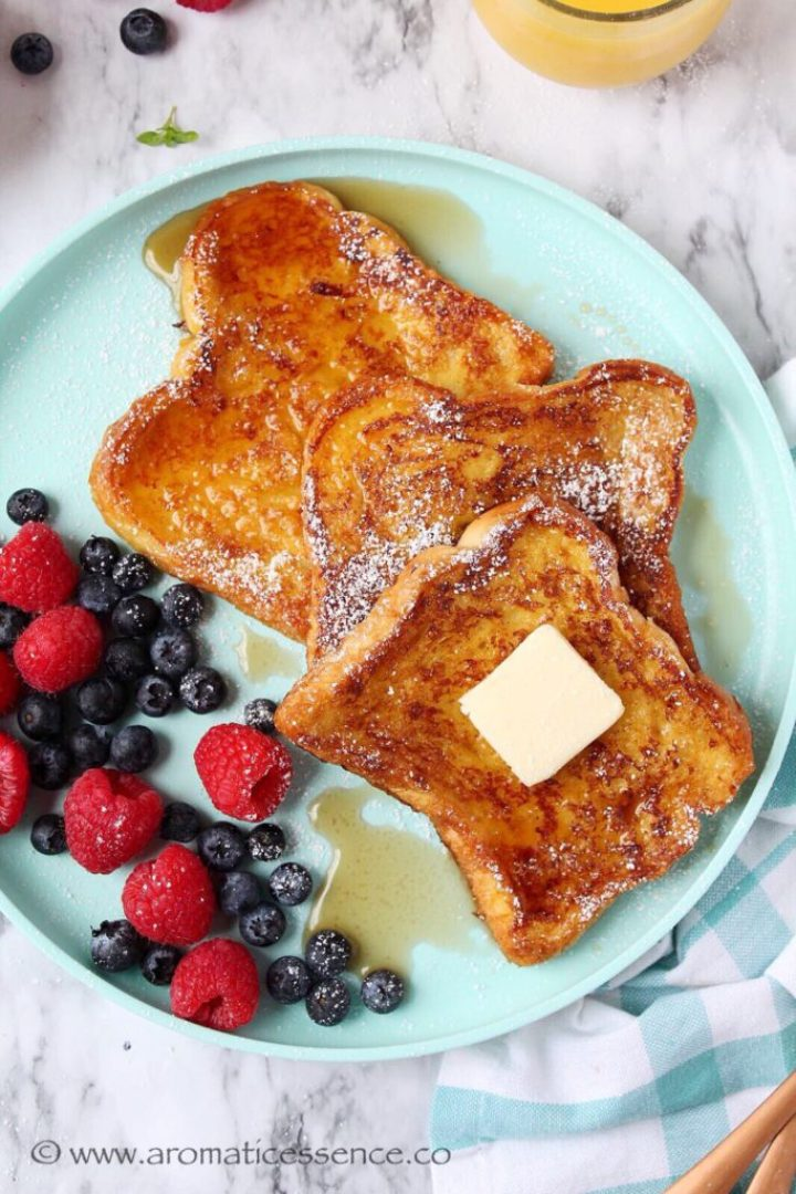 Three slices of French toasts on a blue rimmed plate