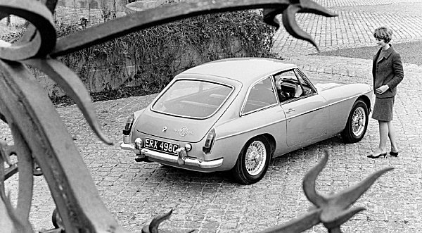 The new to 1965 MGB GT shows off its elegant Pininfarina-designed roofline...