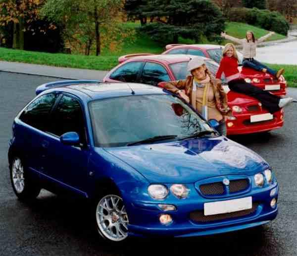 The lovely Atomic Kitten pose by their MG ZRs