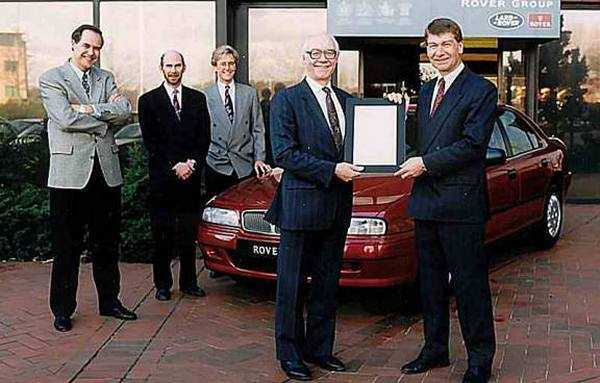 The Rover 600 was the beneficiary of a Design Council Award in March 1994: The three men responsible for the overall style of the car are: (left to right) Gordon Sked, Geoff Upex and Richard Woolley. John Towers (front, right) receives the British Design Award. Industry acknowledgement was very important, but in the case of the Rover 600, it was also well deserved – because it managed to look so different from the mechanically identical Honda Accord. (Picture supplied by Kevin Davis)