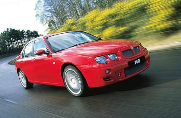 MG ZT being put through its paces for the camera: the subtle retro of the Rover 75 had been replaced by aggressive purposefulness. Buyers liked the new car, and sales in the UK soon lifted appreciably.