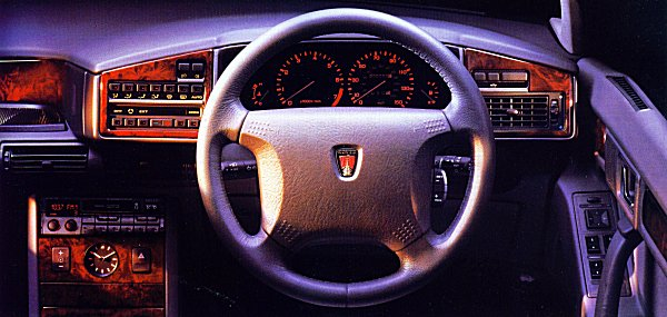 Why change a winning formula? The dashboard receives little in the way of modification over the earlier model - the most obvious changes are limited to the re-siting of the (classy looking) clock and the addition of a new and bulbous looking steering wheel.
