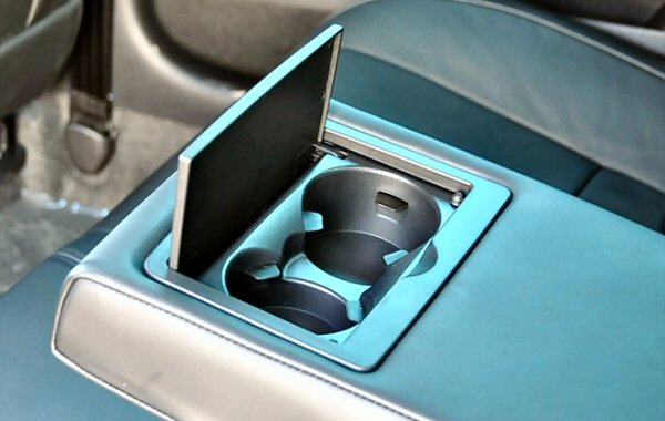 Cupholders all round - these are the rear ones - but reveal some substandard cabin plastics.