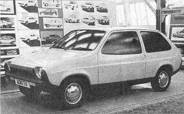 "Another effort from the dipped window-line, bulbous school of thought, with more than a hint of the later Fiat Ritmo about the front. One possible indicator of ""project drift"" is the plethora of wildly differing styling sketches on the wall behind."