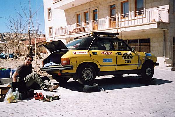 Running repairs and bean-tin exhaust strengthening, Cappodocia, with Nick pretending to do some of the work