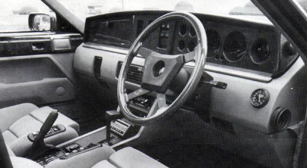 The Prestige's interior, showing the electric seats, walnut-tastic dashboard and inlaid door cappings. Note also the add-on turbo-boost guage, neatly mounted at the extreme right of the lower dashboard rail.