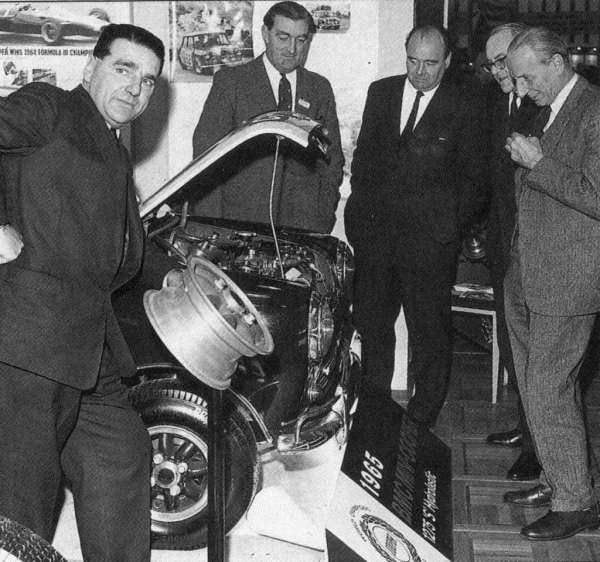 Men on the move taken at the Racing Car Show in 1965 (Left to Right) John Cooper, unknown, Charles Griffin, Bill Appleby and Alec Issigonis. (Picture: Ian Nicholls)