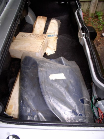 The boot contains never opened accessories, such as a BL radio and luggage rack